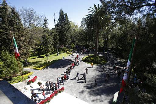 Visitors line up to enter Casa Miguel Aleman on the Los Pinots presidential residence complex, in Mexico City, Saturday, Dec. 1, 2018. In his first day as President, Andres Manuel Lopez Obrador threw open the gates of the the luxurious official residence of presidents since the 1930s and plans to keep it open for the general public as a cultural attraction and an extension of the Chapultepec park.