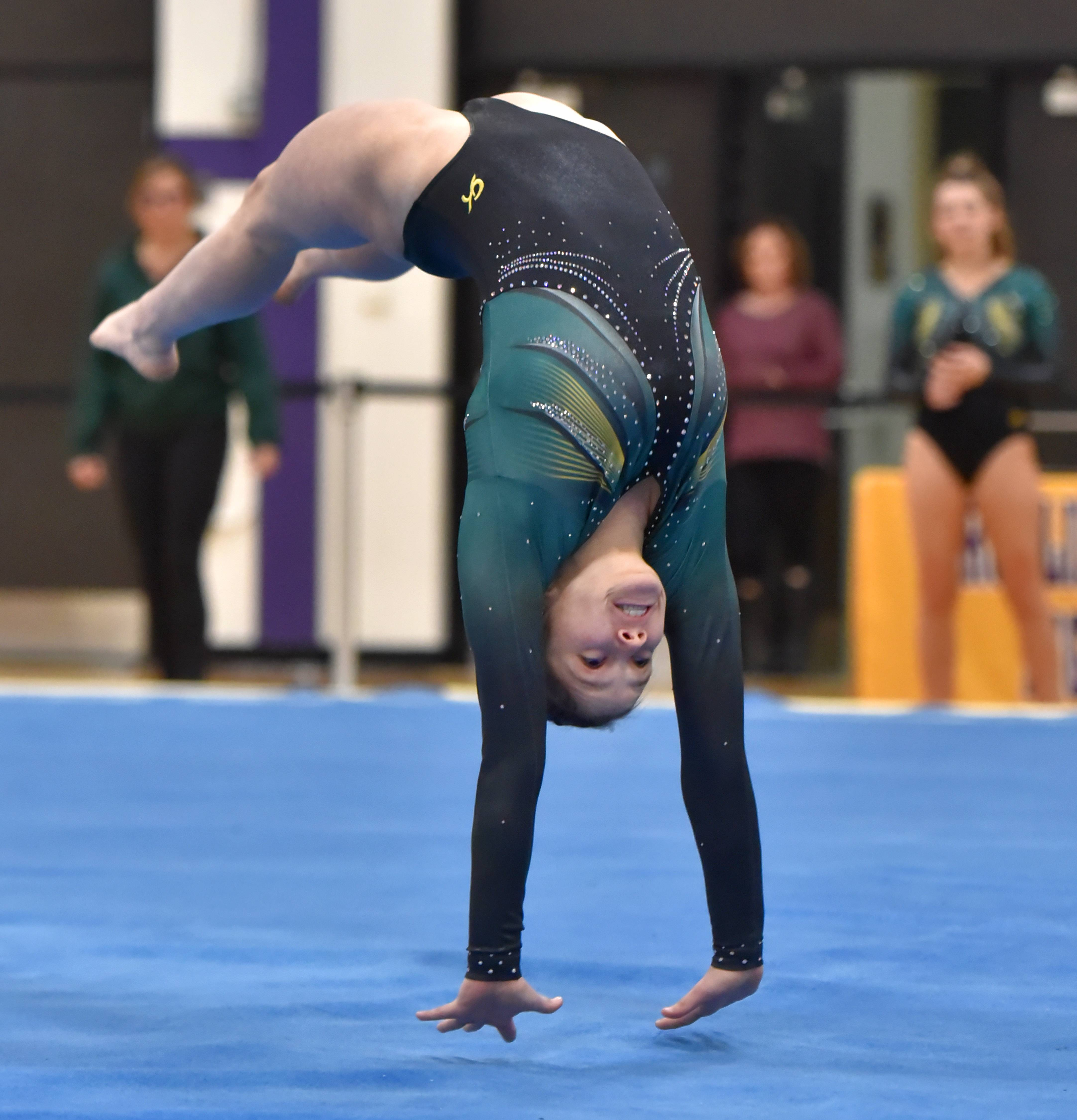 Stevenson's Emily Weinstein performs in the Floor Exercise Saturday at the Rolling Meadows High School girls gymnastics Al Galatte Holiday Invitational.