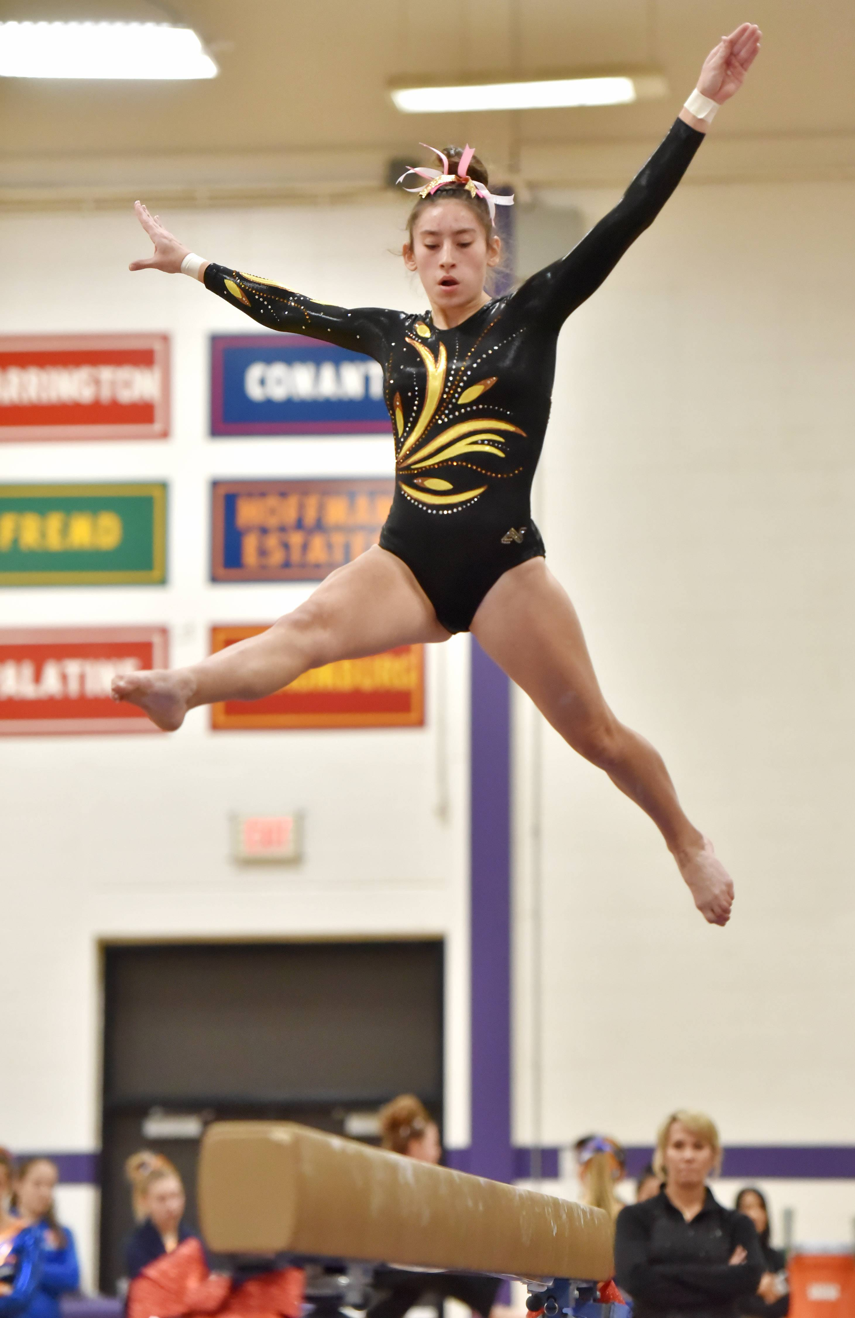 Carmel's Aideen Cazzini performs on the Balance Beam Saturday at the Rolling Meadows High School girls gymnastics Al Galatte Holiday Invitational.