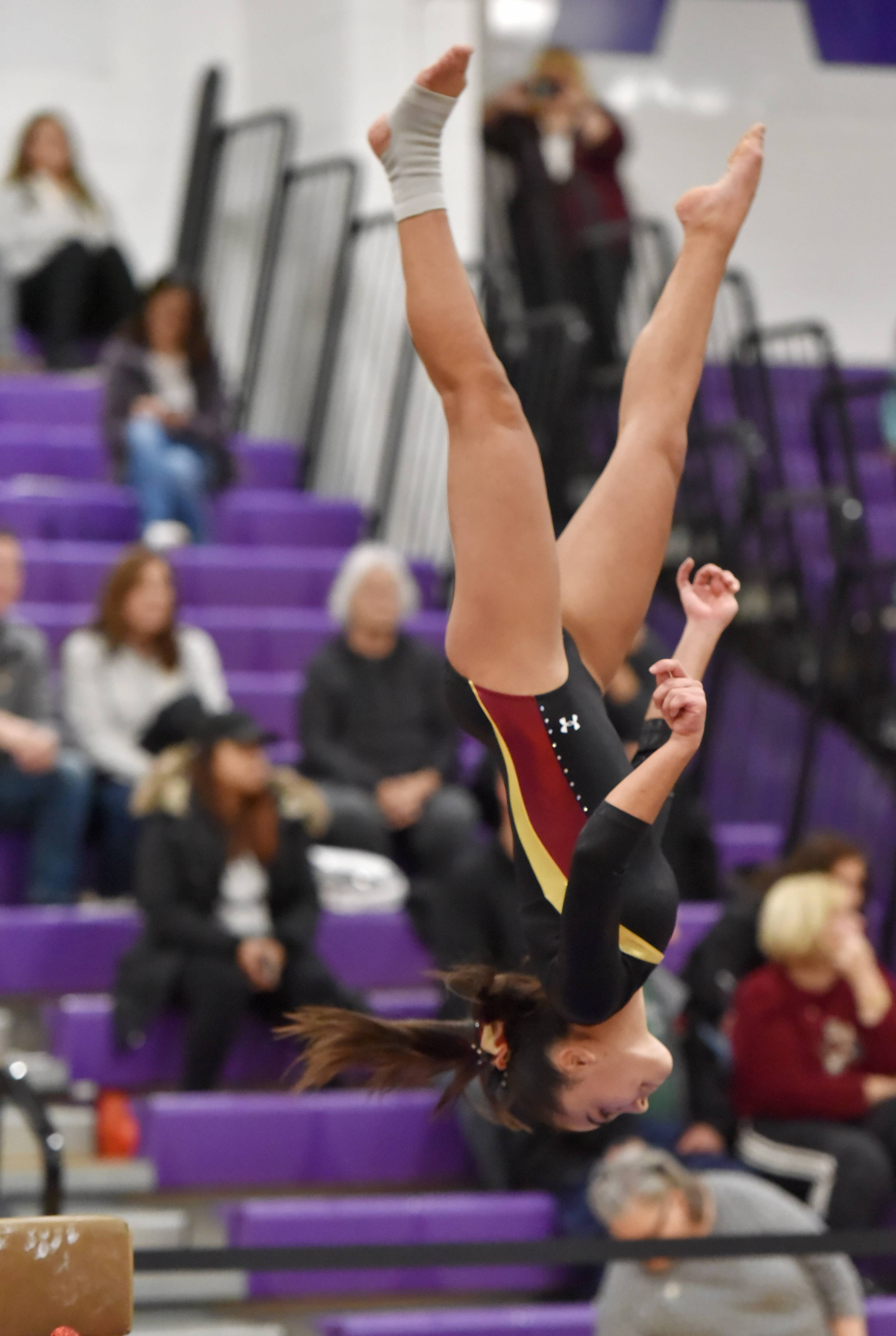 Schaumburg's Mallory Page dismounts the Balance Beam Saturday at the Rolling Meadows High School girls gymnastics Al Galatte Holiday Invitational.