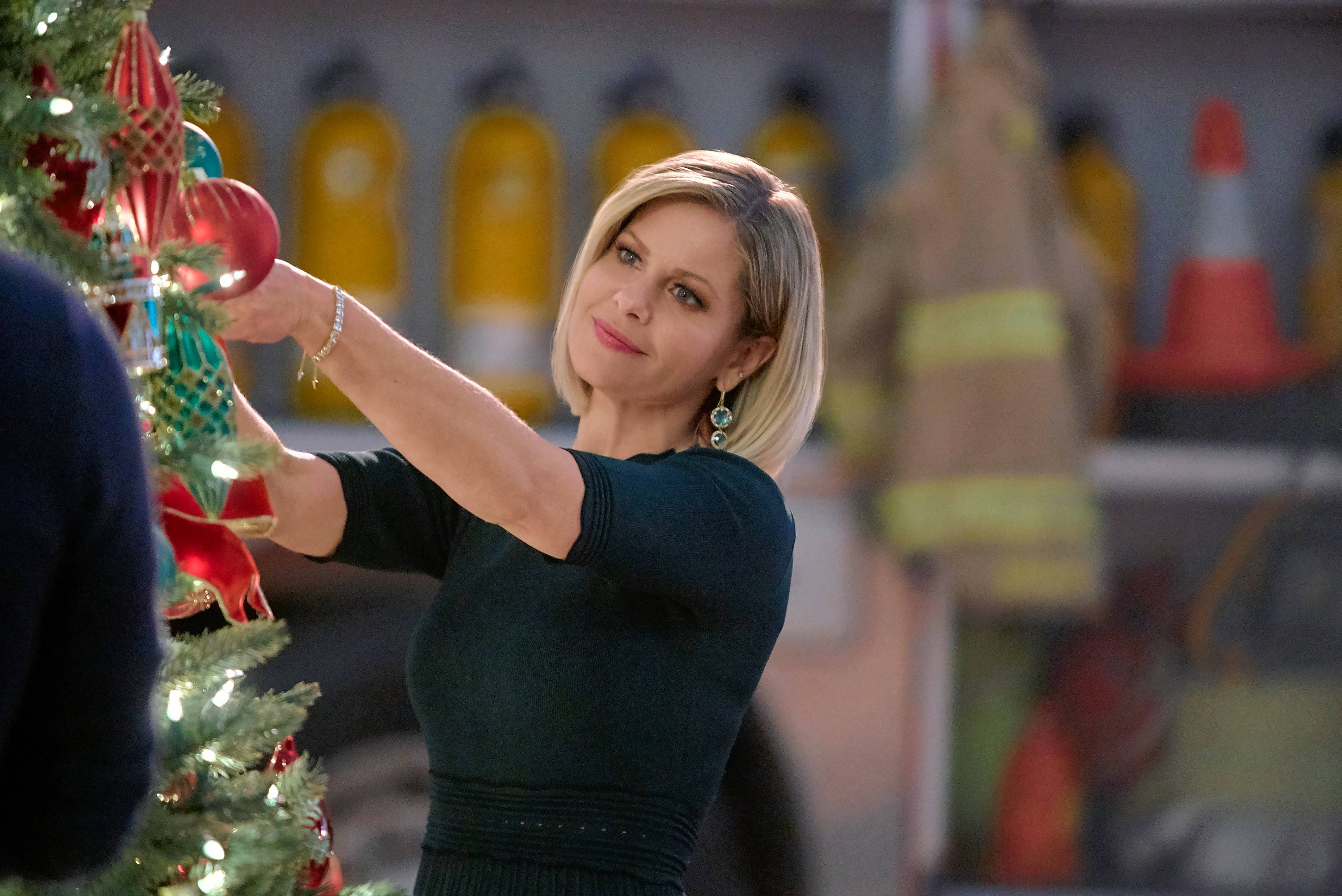 "Candace Cameron Bure stars as a department store worker who rediscovers her holiday spirit in Hallmark's ""A Shoe Addict's Christmas."" It airs next on Saturday, Dec. 1."