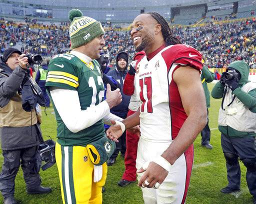Familiar problems plague fading Packers in loss to Cards