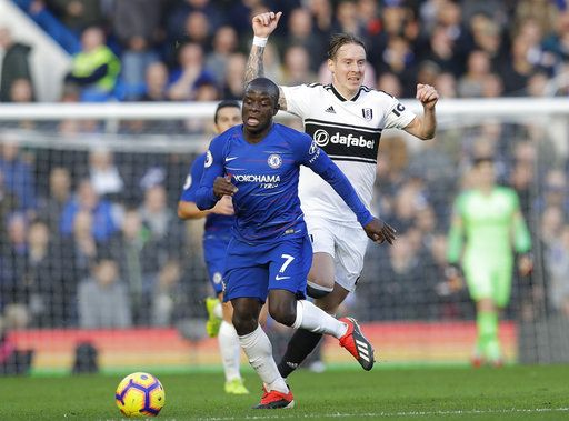 Chelsea's N'Golo Kante, left, challenges for the ball with Fulham's Stefan Johansen during the English Premier League soccer match between Chelsea and Fulham at Stamford Bridge stadium in London, Sunday, Dec. 2, 2018.
