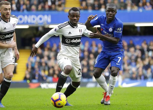Fulham's Jean Michael Seri, center, challenges for the ball with Chelsea's N'Golo Kante during the English Premier League soccer match between Chelsea and Fulham at Stamford Bridge stadium in London, Sunday, Dec. 2, 2018.