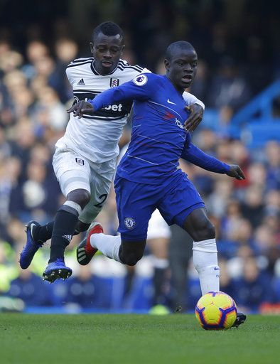 Chelsea's N'Golo Kante, right, challenges for the ball with Fulham's Jean Michael Seri during the English Premier League soccer match between Chelsea and Fulham at Stamford Bridge stadium in London, Sunday, Dec. 2, 2018.
