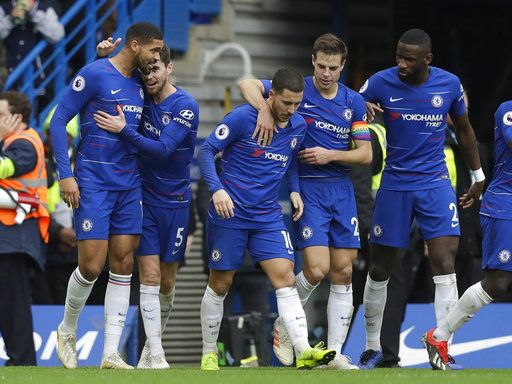 Chelsea's Ruben Loftus-Cheek, left, celebrates with team mates after scoring his side's second goal during the English Premier League soccer match between Chelsea and Fulham at Stamford Bridge stadium in London, Sunday, Dec. 2, 2018.