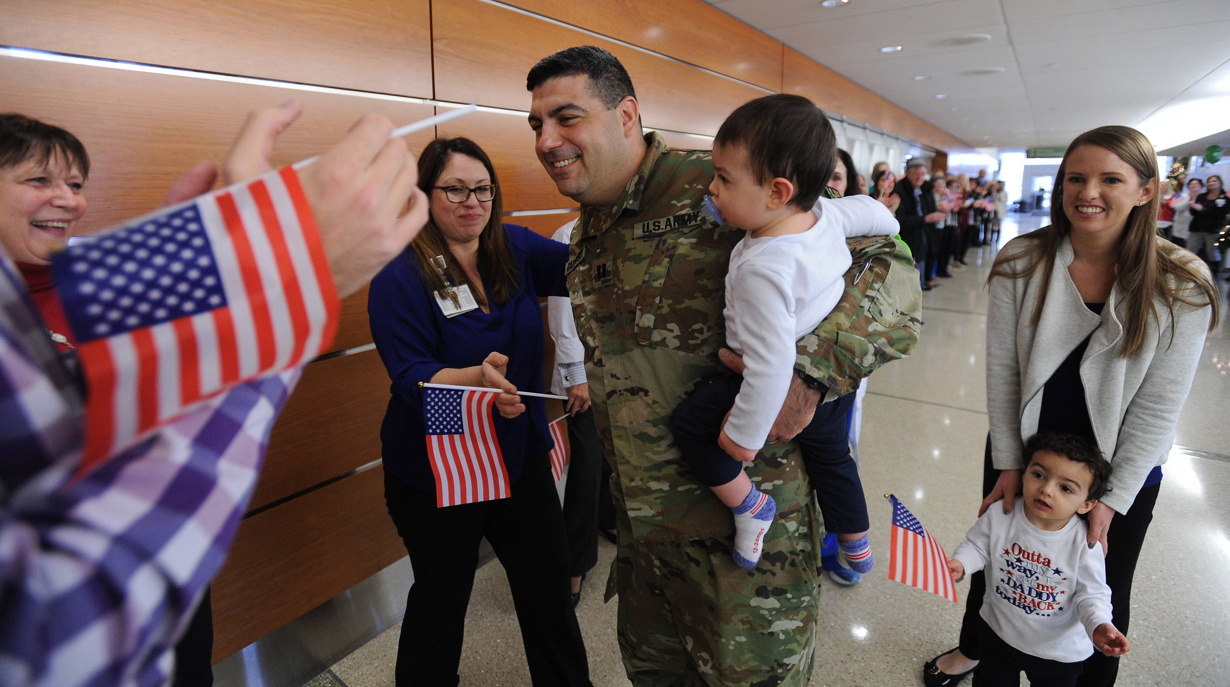 Dr. Jonathan Garlovsky returned to Northwest Community Hospital in Arlington Heights on Monday, joined by his wife, Trisha, and sons Mason, 2, and Nate, 1. The U.S. Army Reserve captain spent three months serving in a military hospital at Camp Arifjan in Kuwait.