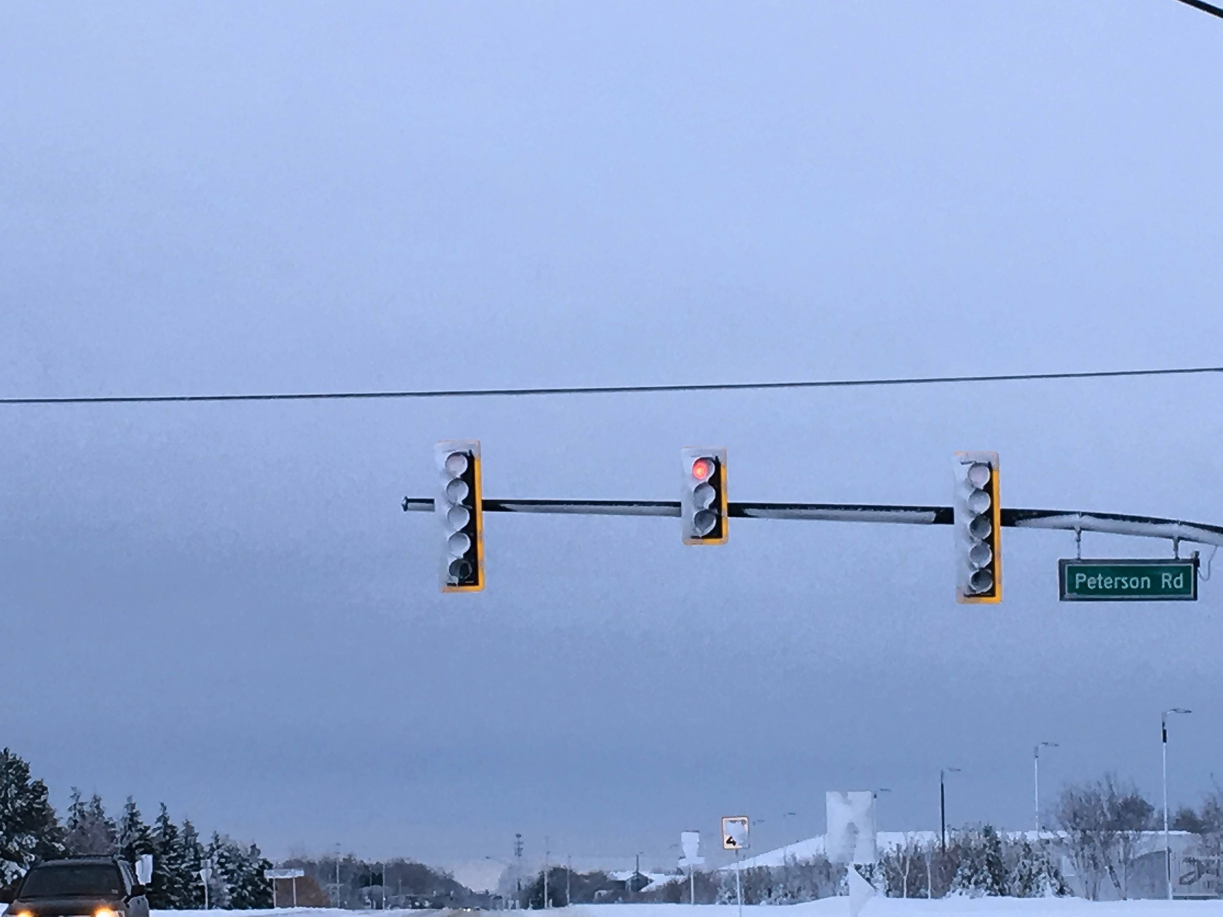 A heater installed in an LED traffic signal at Peterson and Midlothian roads near Libertyville had enough power to melt some snow covering the bulb, but not all.