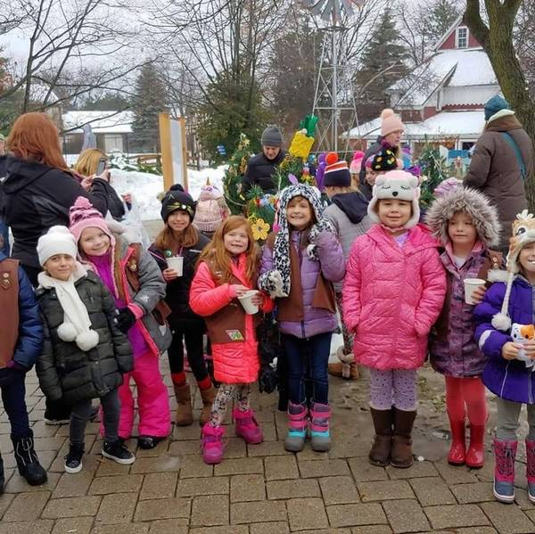 on december 1 queen of the rosary girl scouts enjoy hot chocolate after decorating their