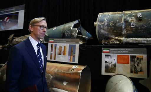 "Brian Hook, U.S. special representative for Iran, walks past fragments of Iranian short range ballistic missiles (Qiam) at the Iranian Materiel Display (IMD) at Joint Base Anacostia-Bolling, in Washington, Thursday Nov. 29, 2018. The Trump administration accused Iran of stepping up violations of a U.N. ban on arms exports by sending rockets and other weaponry to rebels in Afghanistan and Yemen. The presentation displays weapons and fragments of weapons seized in Afghanistan, Bahrain and Yemen that it said are evidence Iran is a ""grave and escalating threat"" that must be stopped."