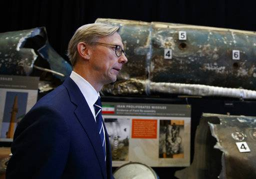 Brian Hook, Special Representative for Iran, walks past pieces of Iranian short range ballistic missiles (Qiam) at the Iranian Materiel Display (IMD) at Joint Base Anacostia-Bolling, in Washington, Thursday Nov. 29, 2018, as he speaks about the Iranian regime's transfer of arms to proxy groups and ongoing missile development.