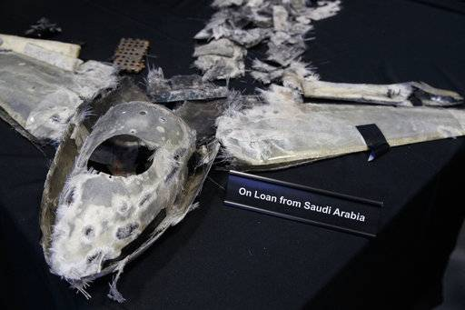 "Debris that was a UAV (Qasef) is displayed with a sign that reads ""On Loan From Saudi Arabia"" at the Iranian Materiel Display (IMD) at Joint Base Anacostia-Bolling, in Washington, Thursday Nov. 29, 2018, after a news conference about the Iranian regime's transfer of arms to proxy groups and ongoing missile development."