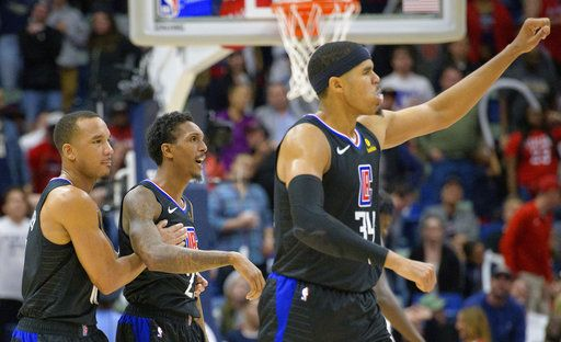 fc59dd33acf Los Angeles Clippers guard Lou Williams (23) is congratulated by guard Avery  Bradley (