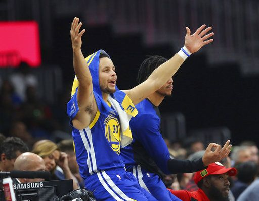 b4388c39c39 Golden State Warriors guard Stephen Curry (30) reacts from the sideline  during the first
