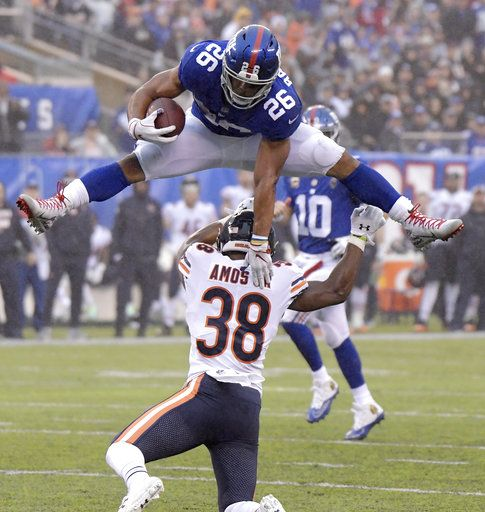 67958d11561 New York Giants running back Saquon Barkley (26) leaps over Chicago Bears  strong safety