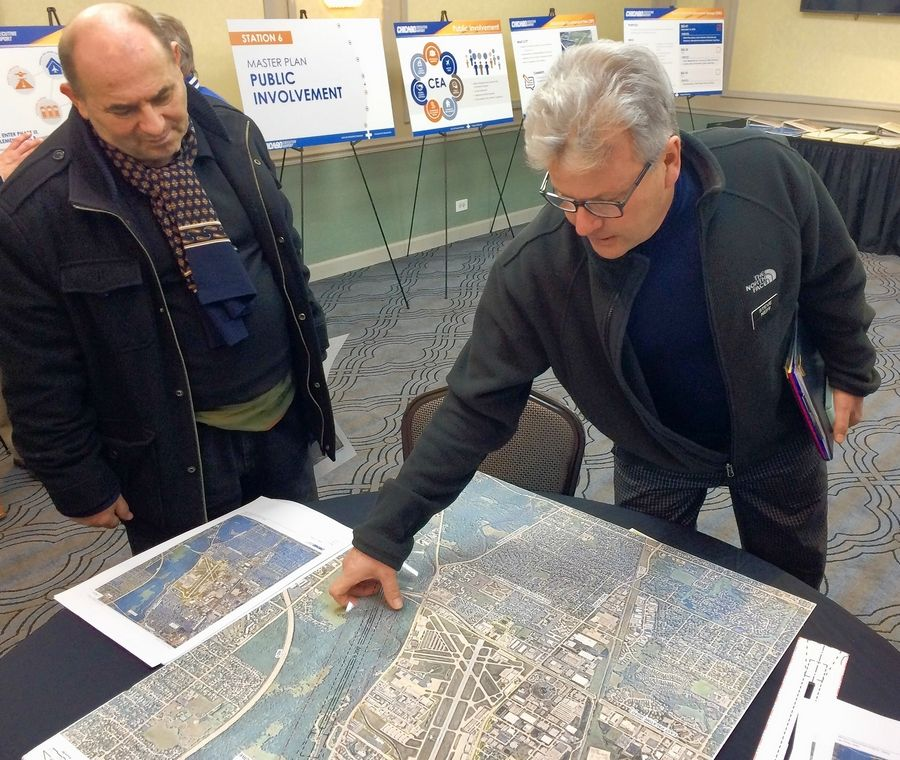 Wheeling resident Steve Neff, right, attended an open house Tuesday for Chicago Executive Airport's work on an updated advisory master plan that could include a longer main runway. Neff is against the idea of an expanded runway and is trying to get an advisory referendum related to the issue on the April ballot.