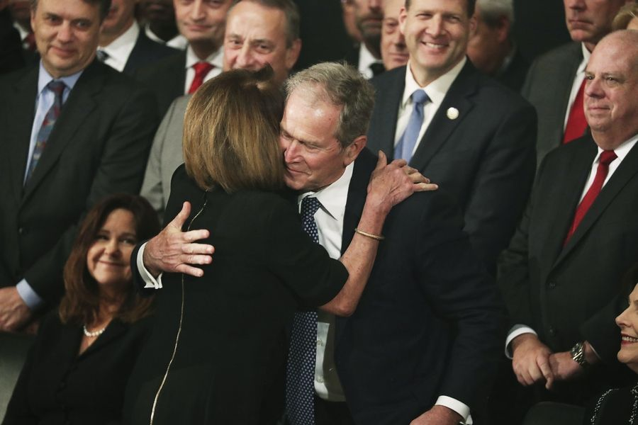 Former President George W. Bush is embraced by Democratic House Leader Nancy Pelosi, D-Calif., during the arrival of the casket of former President George H.W. Bush into the Capitol in Washington, Monday, Dec. 3, 2018. (Jonathan Ernst/Pool Photo via AP)