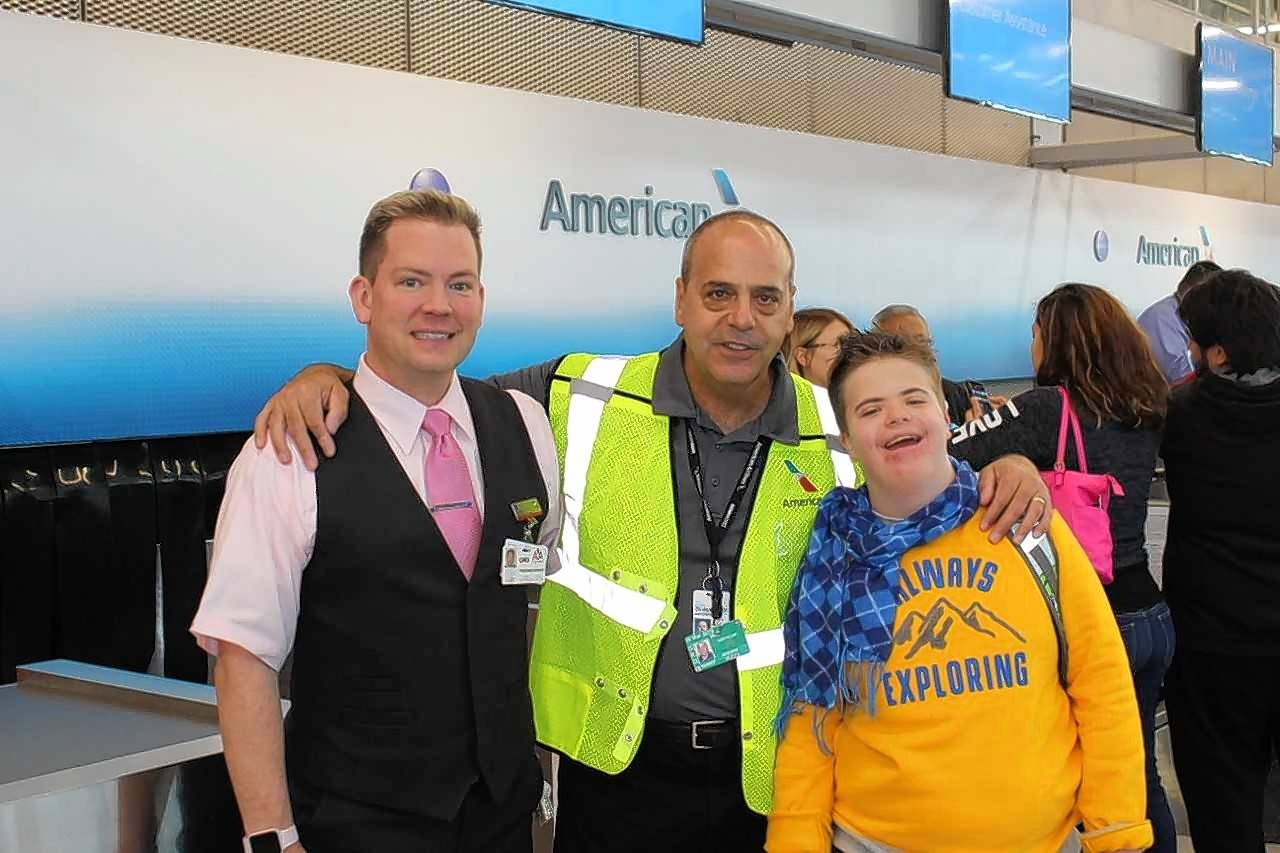 Families with special needs children recently took part in a mock flight with American Airlines to help them become comfortable with air travel. From left are AA customer service agent Daniel Sweeney, Ed Pizza, a senior operations planner with American who has coordinated all of these flights since their inception in 2014, and program participant Wyatt Nelson.