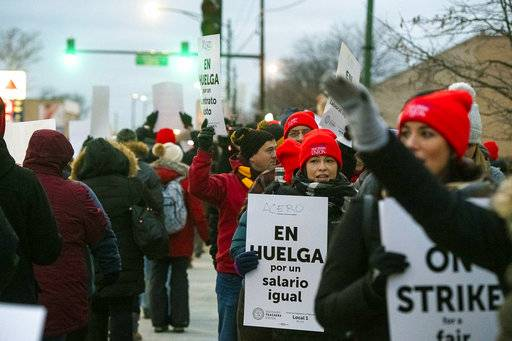 Educators with Acero charter schools strike outside Veterans Memorial Charter School Campus, Tuesday, Dec. 4, 2018, in Chicago. Hundreds of teachers have gone on strike at the Chicago charter school network, leading to canceled classes for thousands of students. (Tyler LaRiviere/Chicago Sun-Times via AP)