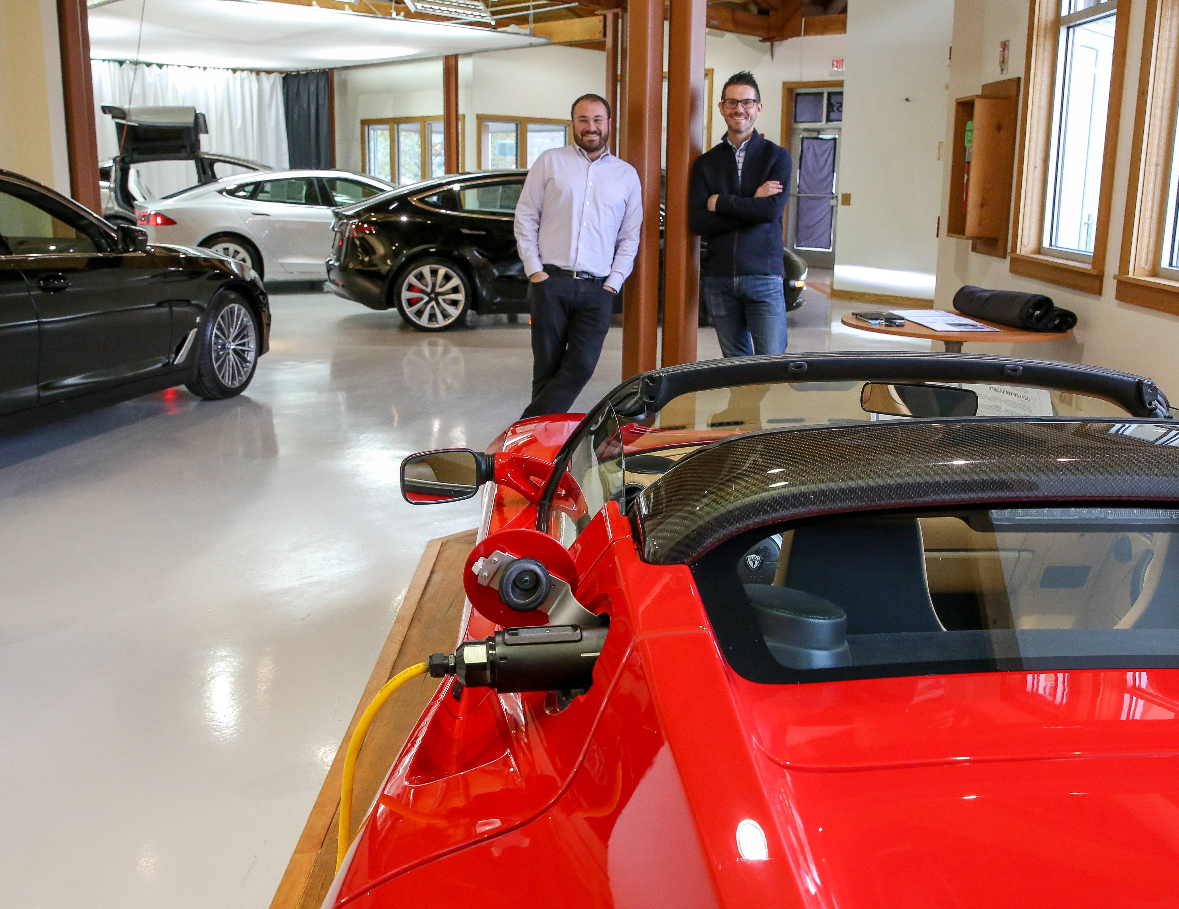 Trip Jacobs and Seneca Giese are co-founders of Current Automotive in Naperville, which exclusively sells used electric vehicles, such as this Tesla Roadster, and plug-in hybrids. The online-focused business has sold cars to 28 states since launching in July.