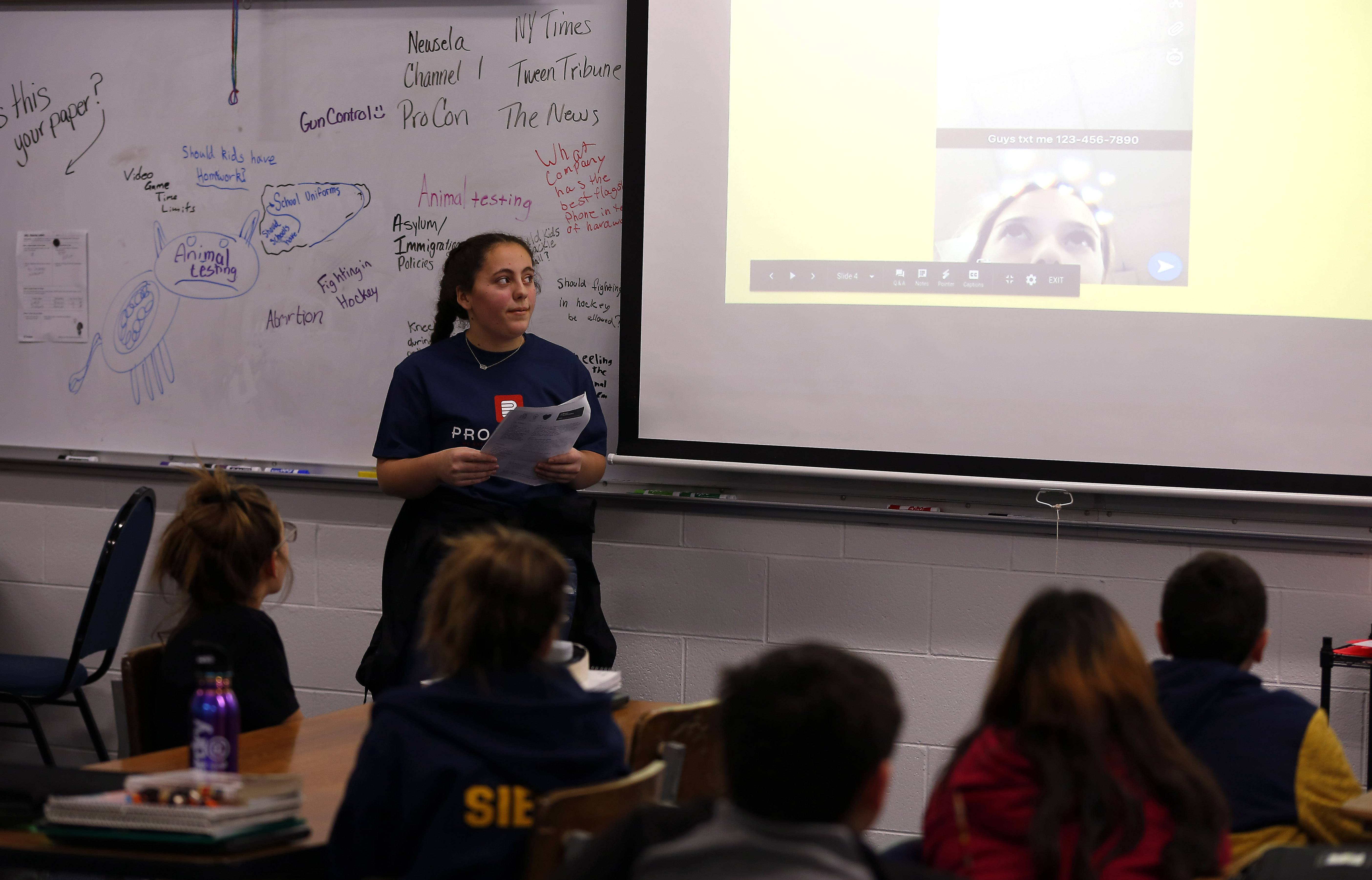 "Eighth-grader Delaney Hausch talks to a sixth-grade class at Bernotas Middle School in Crystal Lake about dangers online. Crystal Lake Elementary District 47 eighth graders are helping guide their peers about internet safety and digital citizenship as part of a student-led program, Project B3 -- ""Be Smart. Be Safe. Be Kind."" Students cover topics such as online safety, a digital footprint and cyberbullying."