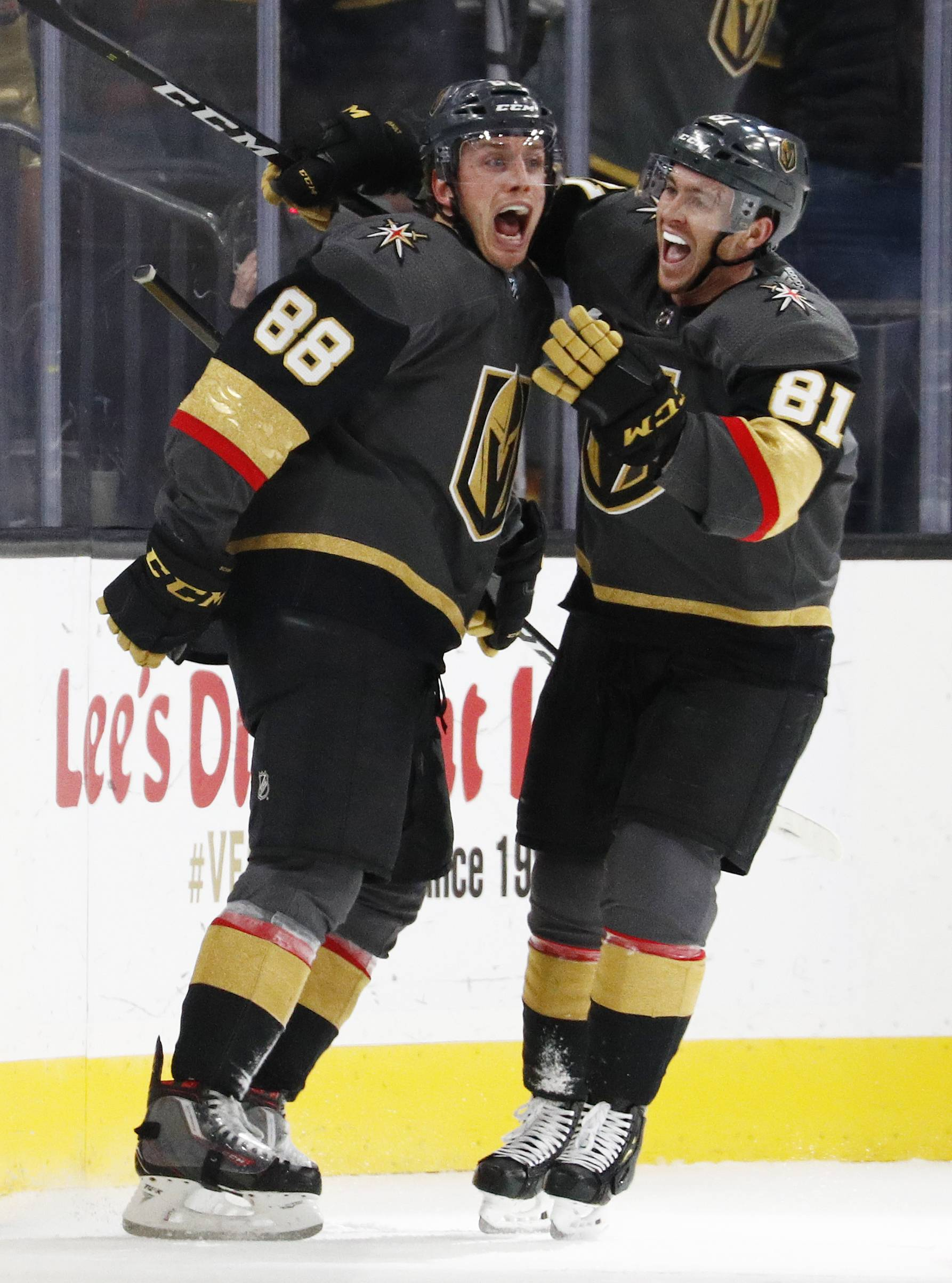Vegas Golden Knights defenseman Nate Schmidt (88) is congratulated by Jonathan Marchessault after scoring the game-winner in the third period Tuesday against the Washington Capitals.