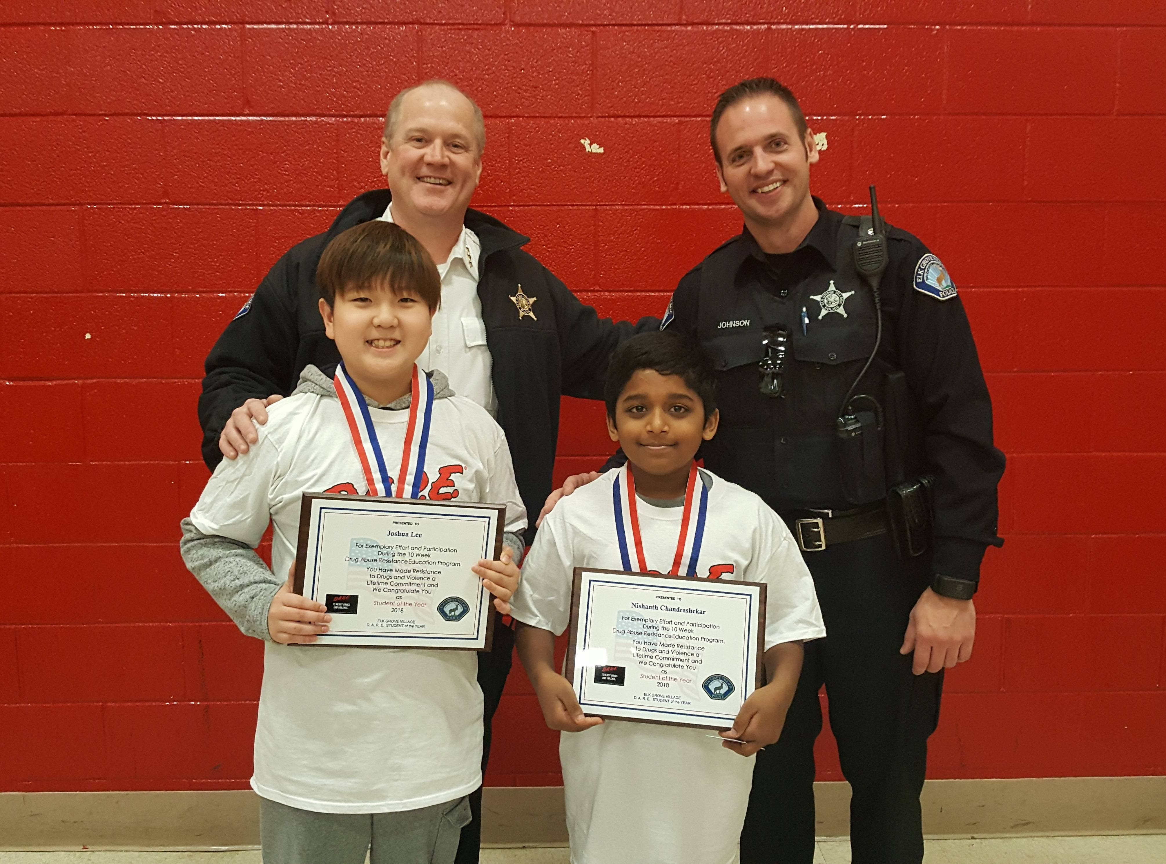 Elk Grove Village Police Chief Charles Walsh and Officer Johnson pictured with students from Link Elementary School.