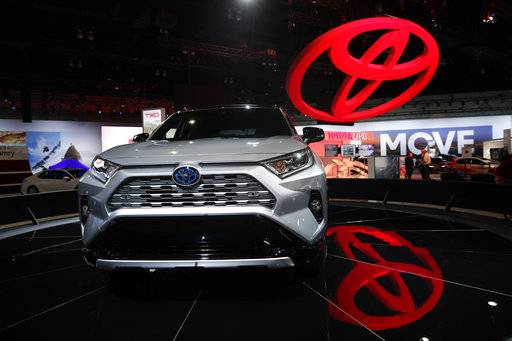 FILE- In this Nov. 28, 2018, file photo the 2019 Toyota RAV4 is displayed at the Los Angeles Auto Show in Los Angeles. Toyota's top U.S. executive says car sales nationwide have bottomed out and his company will keep making them despite a dramatic shift to trucks and SUVs. U.S. CEO Jim Lentz told the Detroit Economic Club Wednesday, Dec. 5, that car sales fell below 30 percent of sales last month, and he thinks that's close to the bottom.