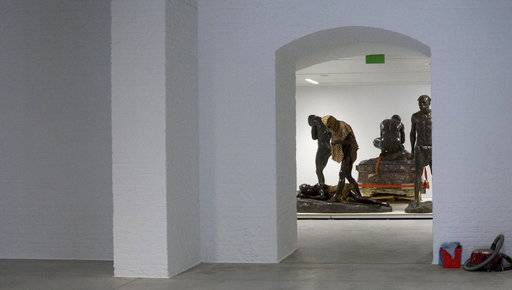 African statues are stored in a cavernous room at the Africa Museum in Tervuren, Belgium, Friday, Aug. 3, 2018. The museum is reopening on Saturday Dec. 8, 2018, after more than 10 years spent revamping the building and overhauling its dated, one-sided approach to history.