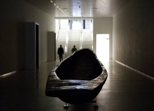 A wooden canoe, carved out of one piece of wood, in the main underground hallway leading to the Africa Museum in Tervuren, Belgium, Friday, Aug. 3, 2018. The museum is reopening on Saturday Dec. 8, 2018, after more than 10 years spent revamping the building and overhauling its dated, one-sided approach to history.