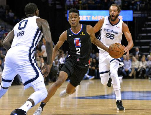 Los Angeles Clippers guard Shai Gilgeous-Alexander (2) drives between Memphis Grizzlies forward JaMychal Green (0) and Memphis Grizzlies center Joakim Noah (55) in the first half of an NBA basketball game Wednesday, Dec. 5, 2018, in Memphis, Tenn.