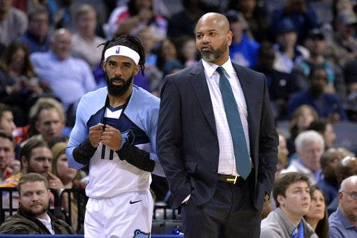 Memphis Grizzlies guard Mike Conley (11) talks with head coach J.B. Bickerstaff in the first half of an NBA basketball game against the Los Angeles Clippers Wednesday, Dec. 5, 2018, in Memphis, Tenn.