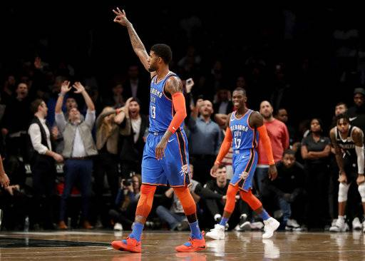 Oklahoma City Thunder forward Paul George gestures after scoring a basket to give his team the lead in a come from behind 114-112 victory over Brooklyn Nets during the second half of an NBA basketball game, Wednesday, Dec. 5, 2018, in New York. AP Photo/Julio Cortez)