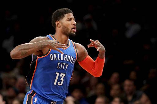 Oklahoma City Thunder forward Paul George gestures after scoring a basket against the Brooklyn Nets during the second half of an NBA basketball game, Wednesday, Dec. 5, 2018, in New York. The Thunder won 114-112.