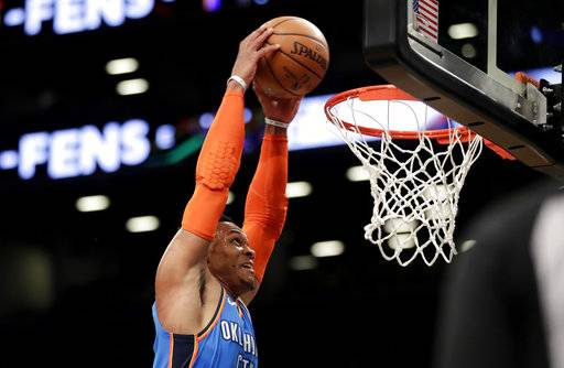 Oklahoma City Thunder guard Russell Westbrook dunks on the Brooklyn Nets during the first half of an NBA basketball game, Wednesday, Dec. 5, 2018, in New York.