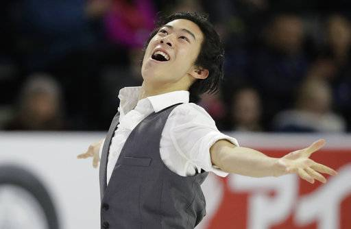 FILE - In this Friday, Oct. 19, 2018, file photo, Nathan Chen performs during the men's short program at Skate America, in Everett, Wash. U.S. figure skater Chen will be trying to defend his Grand Prix Final title in Vancouver, British Colombia, beginning Thursday, Dec. 6, 2018.