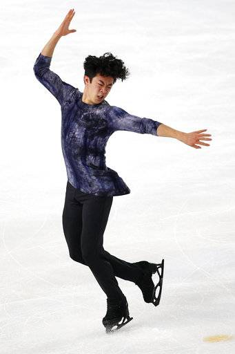 FILE - In this Saturday, Nov. 24, 2018, file photo, Nathan Chen competes in the men's free skating program during the ISU figure skating France's Trophy, in Grenoble, France. U.S. figure skater Chen will be trying to defend his Grand Prix Final title in Vancouver, British Colombia, beginning Thursday, Dec. 6, 2018.
