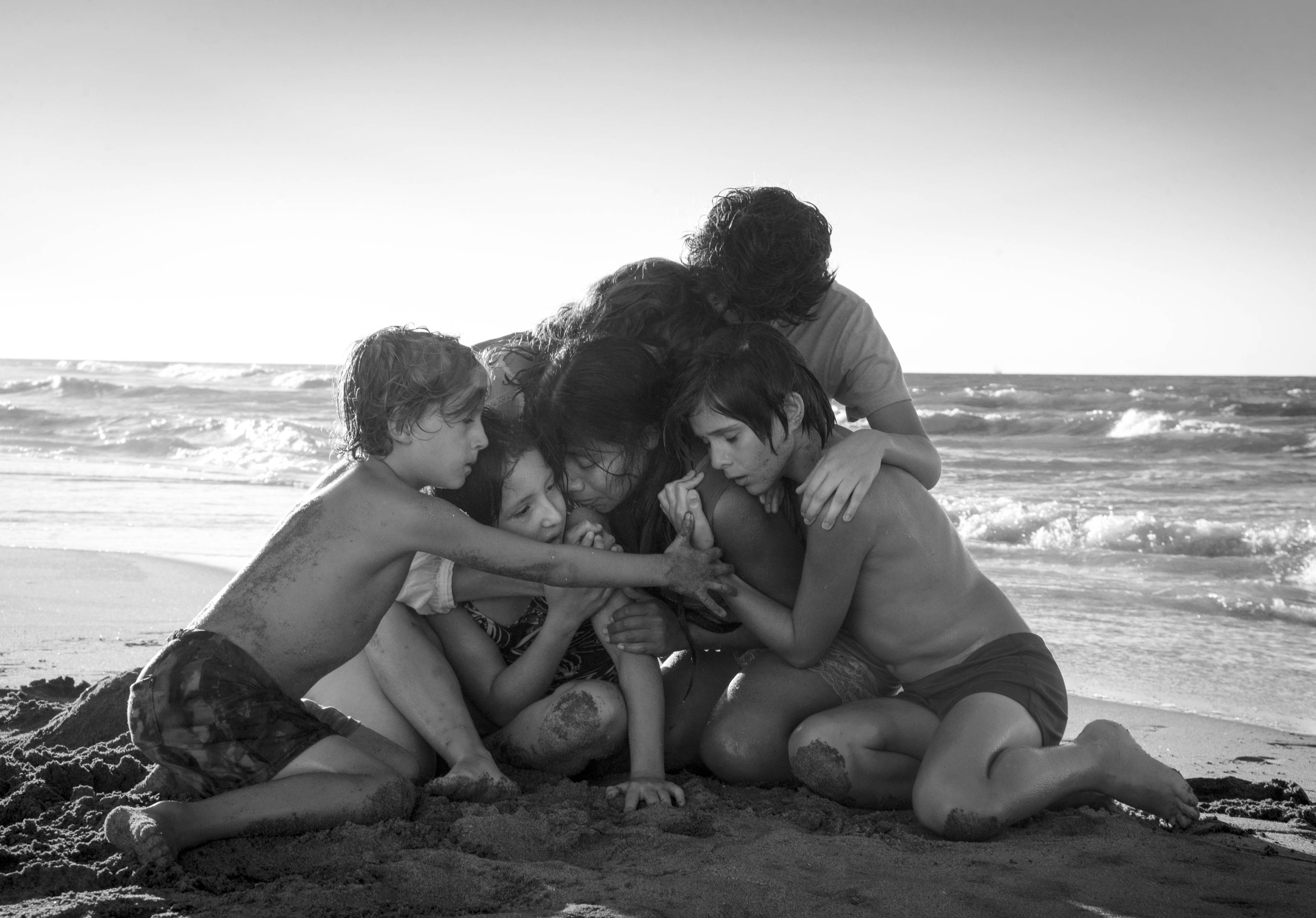 "This image released by Netflix shows Yalitza Aparicio, center, in a scene from the film ""Roma,"" by filmmaker Alfonso Cuaron. On Thursday, Dec. 6, 2018, the film was nominated for a Golden Globe award for best foreign language film. The 76th Golden Globe Awards will be held on Sunday, Jan. 6."