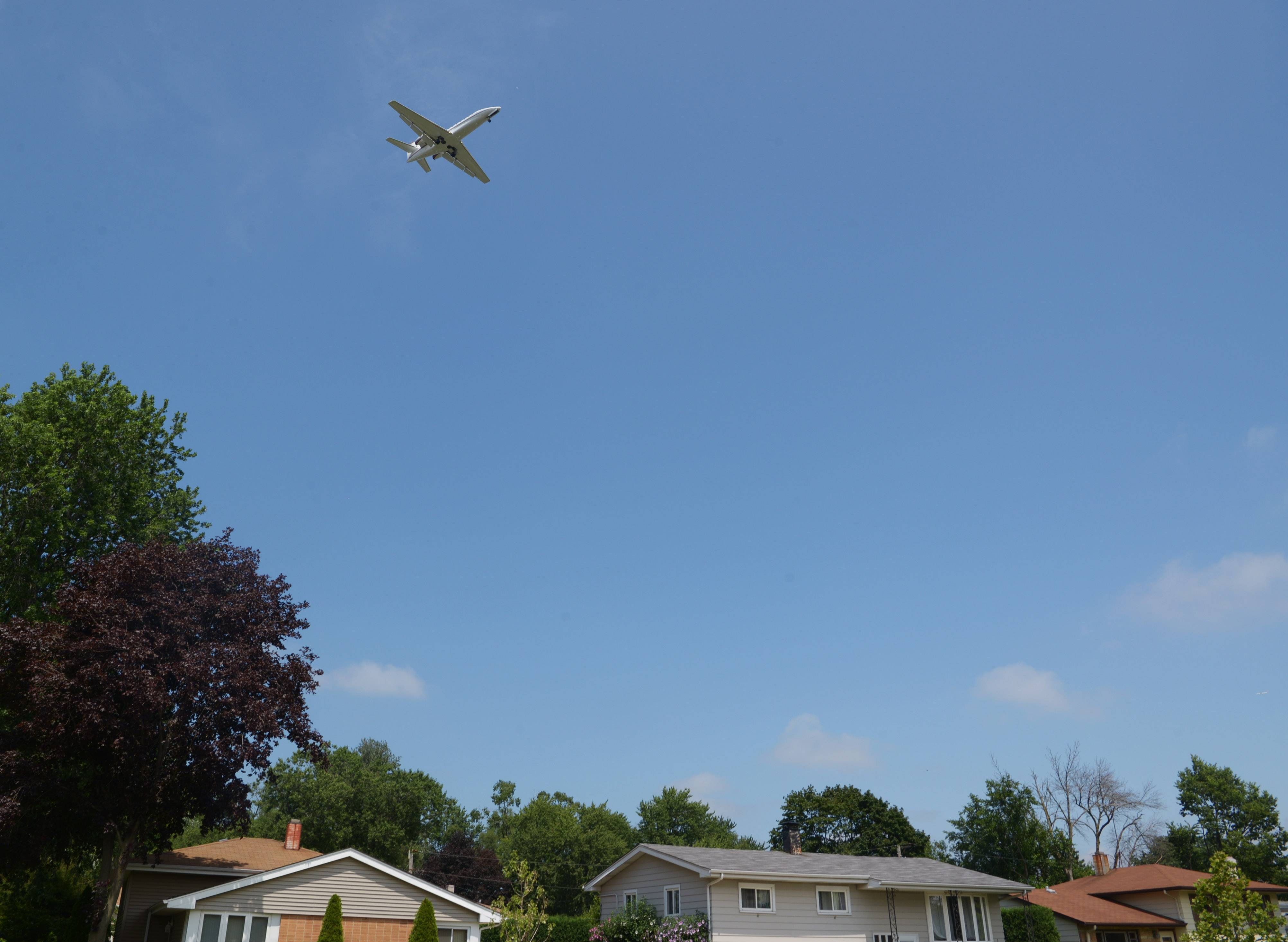 Chicago Executive Airport intends to launch a trial sound insulation program that would provide new doors, windows and other noise-reducing measures to homes nearby. Here, a jet passes over Wheeling homes before landing. The airport is co-owned by Wheeling and Prospect Heights.