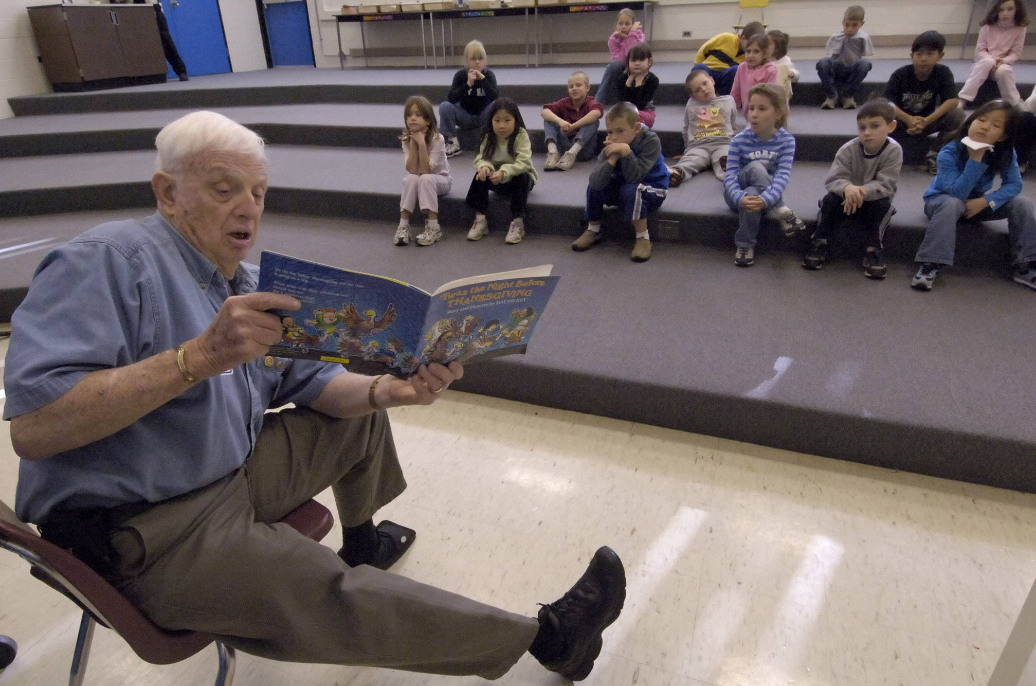 Buffalo Grove resident Ernie Karge, shown reading to elementary students in 2005, was honored posthumously this week by village leaders. Karge spent decades serving the community through numerous clubs and organizations.