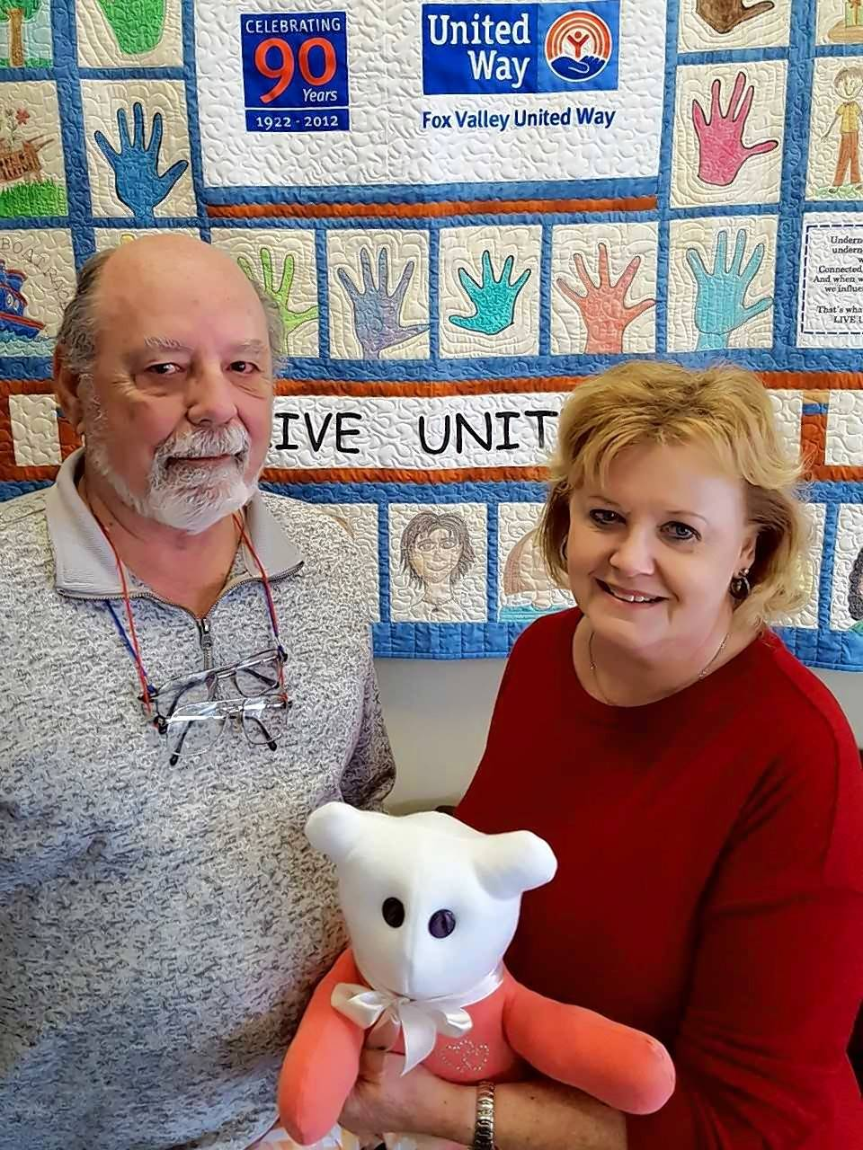 Mike and Jen Reemts of Aurora were the first couple named the Fox Valley United Way's Volunteers of the Year. They help with the organization's holiday assistance program for local families. Jen also sews bears, middle, made from sentimental shirts and clothing from deceased loved ones for the Fox Valley Hands of Hope.