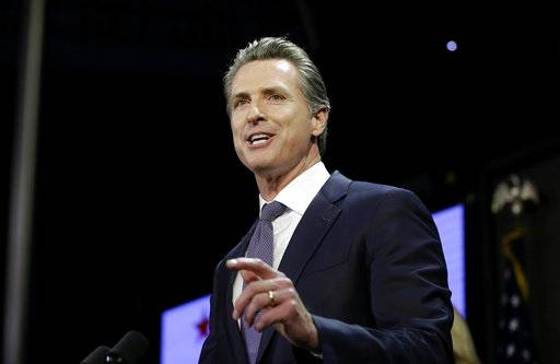 FILE- In this Nov. 6, 2018 file photo, Gavin Newsom, addresses an election night crowd to become the 40th governor of California in Los Angeles. With new Democrats set to take over the governor's mansion across the country, the charter school movement may face a shifting political landscape in a number of key states.