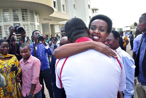 Diane Rwigara, the country's most prominent opposition figure, is hugged by a wellwisher after being acquitted of charges related to her election challenge of President Paul Kagame, at the high court in Kigali, Rwanda Thursday, Dec. 6, 2018. Rwanda's high court on Thursday acquitted Rwigara of all charges, as judges said the prosecution failed to provide proof of insurrection and forgery.