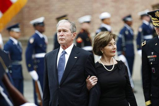 Former President George W. Bush and his wife, Laura Bush, leave St. Martin's Episcopal Church in Houston after the funeral service for his father, former President George H.W. Bush on Thursday, Dec. 6, 2018.