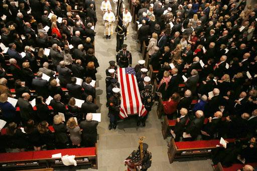 The flag-draped casket of former President George H.W. Bush is carried by a joint services military honor guard from St. Martin's Episcopal Church Thursday, Dec. 6, 2018, in Houston.