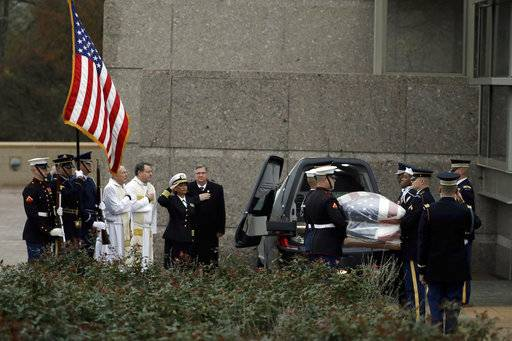 The flag-draped casket of former President George H.W. Bush is carried by a joint services military honor guard as it arrives at the George H.W. Bush Presidential Library and Museum Thursday, Dec. 6, 2018, in College Station, Texas, for burial.