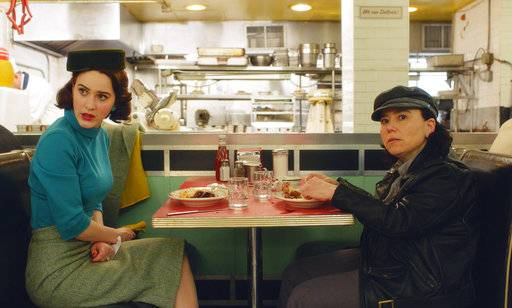 "This image released by Amazon shows Rachel Brosnahan, left, and Alex Borstein in a scene from ""The Marvelous Mrs. Maisel."" On Thursday, Dec. 6, 2018, Borstein was nominated for a Golden Globe award for supporting actress in a series, limited series or TV movie for her role. The 76th Golden Globe Awards will be held on Sunday, Jan. 6. (Amazon via AP)"