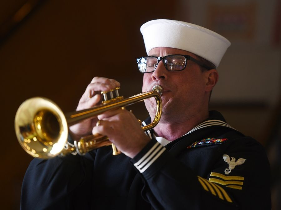 Sailor Michael Bogart plays taps during a ceremony commemorating the anniversary of the Pearl Harbor attack.