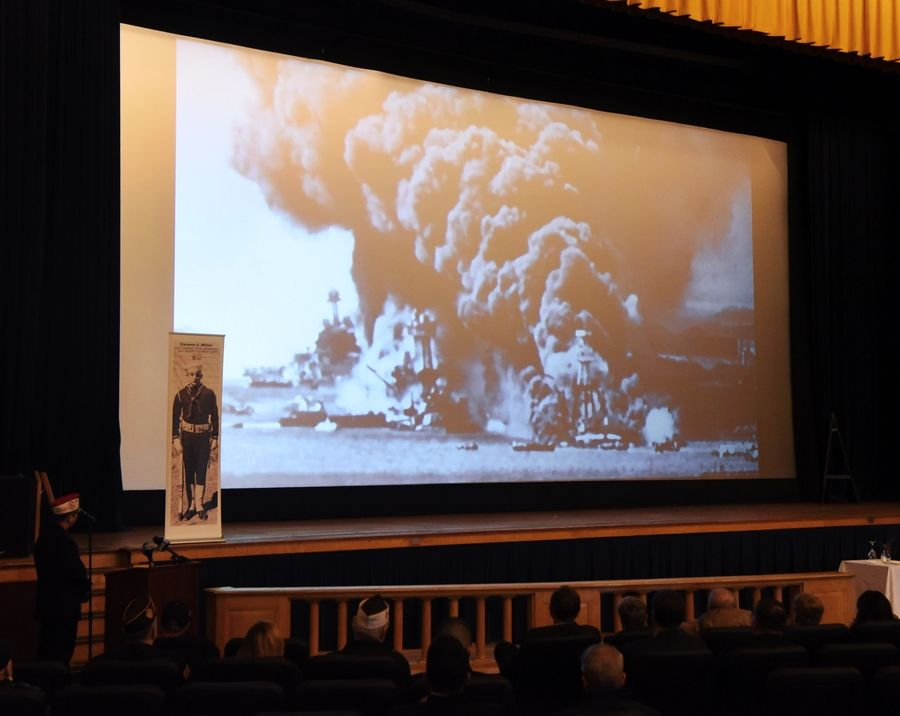 A short film is shown during a Pearl Harbor commemoration ceremony at Great Lakes Naval Station near North Chicago Friday.