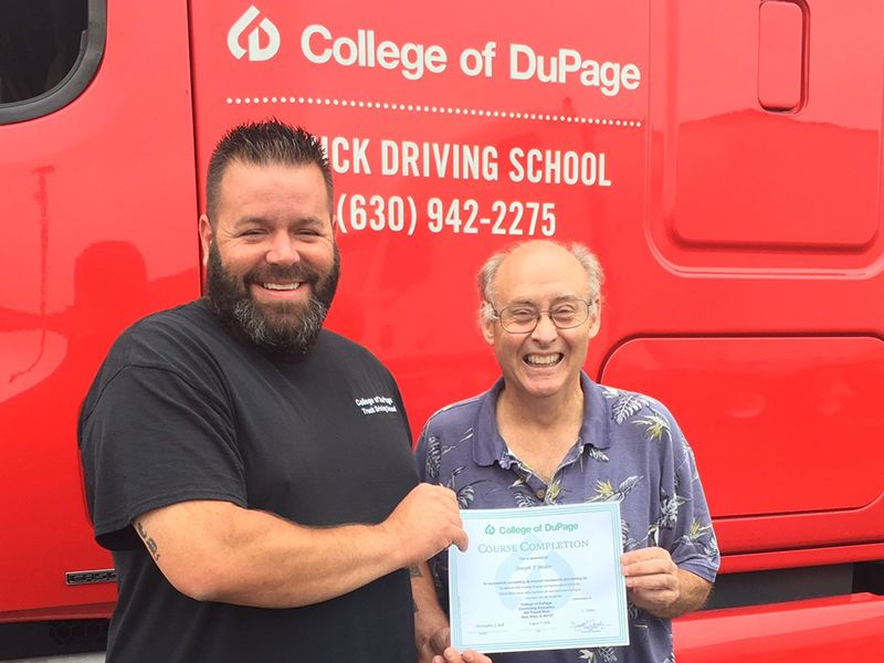 Former College of DuPage student Joseph Miller, right, with commercial driver's license instructor Chris Bell, says while driving over the road can be challenging and stressful at times, he's enjoying his work behind the wheel.